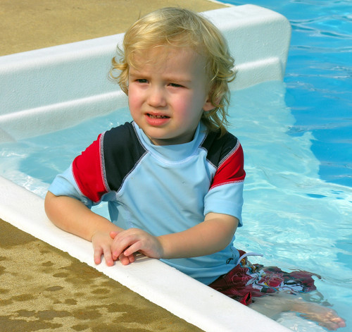 posing at a pool party